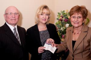 Tamworth Co-operative Society's funeral manager Amanda Woodward, deputy funeral manager Bill Galvin and Sue Williams, chair of Cruse South Staffordshire, pictured at the cheque presentation.