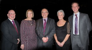 Tamworth Co-op chief executive Julian Coles (centre) is pictured with the four employees who were presented with long service awards at the dinner dance. They are (from left to right) Bill Galvin, Judith Lees, Sue Williams and Dan Welsh.
