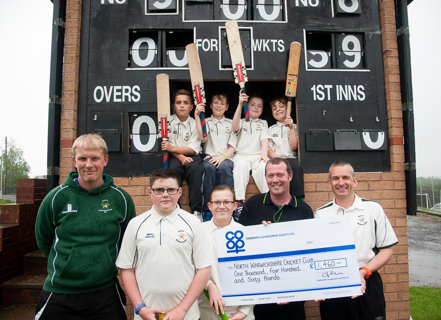Karl Vyse, manager of Tamworth Co-op Polesworth store, is pictured (second from right) handing over the cheque to North Warwickshire Cricket Club treasurer Steve Hern (right), with Rich Stonehouse (left), club's first team vice-captain and junior coach, and junior team players holding up their bats in celebration.