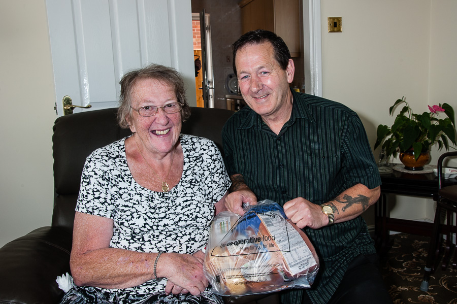 Housebound pensioner Joan Porrett has her shopping delivered to her home every week. Home delivery driver Barry Scully is pictured with her.