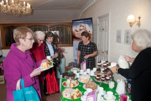 Coffee is served….residents enjoying refreshments at Macmillan fundraiser.
