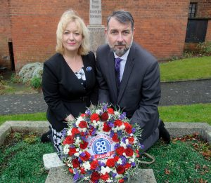 Amanda Woodward, general manager of Tamworth Co-operative Society's funeral division, and deputy funeral manager Glen Speak lay wreath on founder William MacGregor's grave at St Chad's Church, Hopwas to mark 130th anniversary.