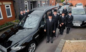 Tamworth Co-op funeral staff pictured with new funeral fleet at division's headquarters in Upper Gungate.