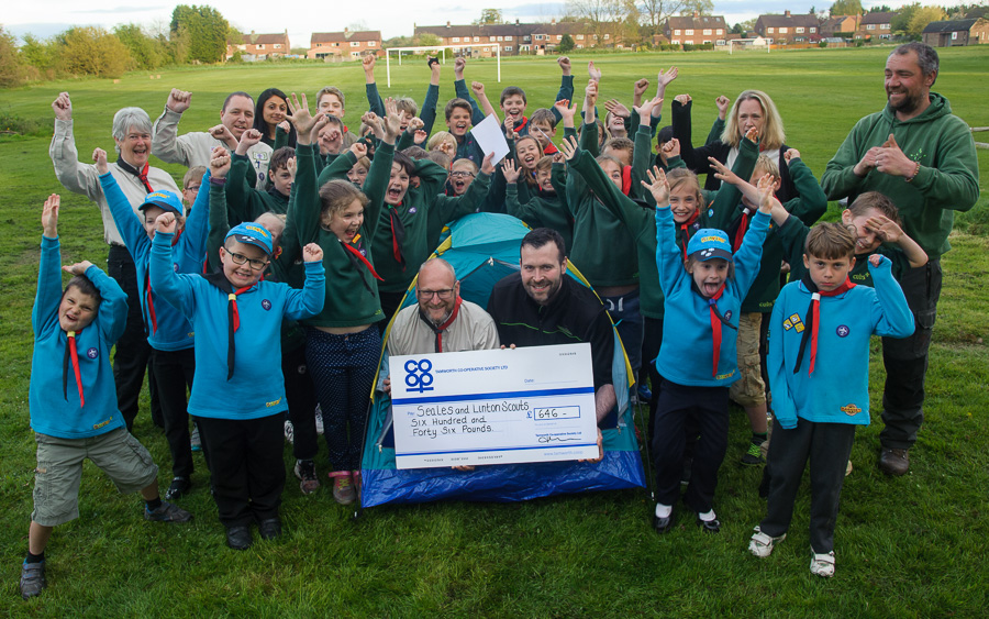 PICTURE CAPTION: Neil Wakelin, manager of the Tamworth Co-op convenience store in Rosliston, presents the cheque from the Community Dividend Fund to Seales and Linton Scouts group leader Andy Winebloom, cheered by the cubs, beavers and scouts and volunteers.