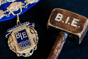 BIE president's chain of office and historic gavel.