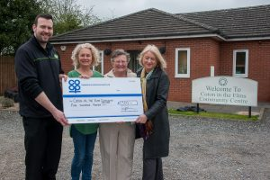 Neil Wakelin, manager of Rosliston Co-op, presents Community Dividend Fund cheque to Sam Towers, chairperson of Coton in the Elms Community Centre, with management committee member Margaret Parkes and trustee Peggy Proffer.