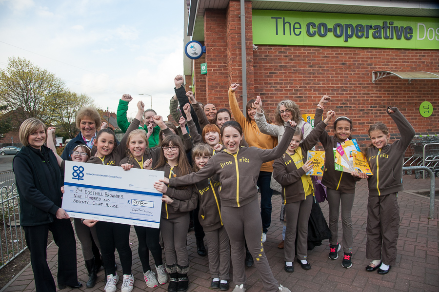 Vicky Freeman, manager of Dosthill Co-op, presents cheque for £978 to overjoyed 2nd Dosthill Brownies and their leader Jill Longhurst.