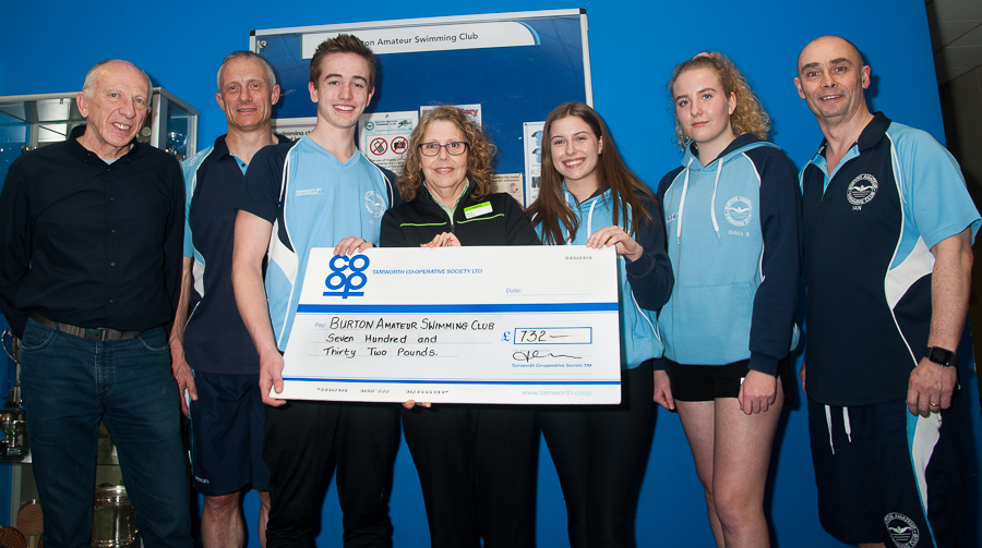 Pictured handover of Community Dividend Fund cheque are members of Burton Amateur Swimming Club with Marina Hutton, manager of Stretton Co-op.