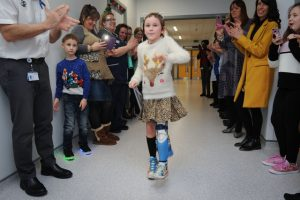 Amelia Eldred walking on her new artificial limb at Birmingham Children's Hospital.