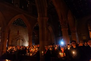 Hundreds of people holding lit candles at Tamworth Co-op Christmas Memorial Service