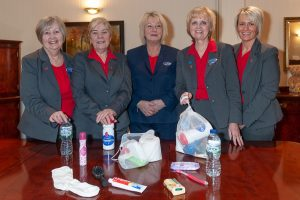 Tamworth Co-op funeral staff with care bags for homeless