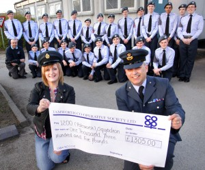 Tamworth Co-op business support manager Julie Gasper presents Flt Lt Gavin Walker with a cheque for £1,305 in front of a group of delighted cadets