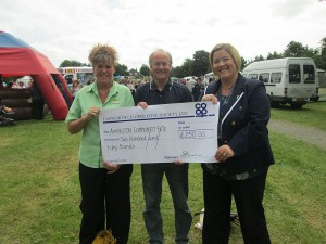 Nicola Gilbert, manager of the Tamworth Co-op convenience store in Amington hands over a cheque for £250 to Rev Mike Harris, the Vicar of Amington. Also pictured is Cllr Tina Clements, who was the Mayor of Tamworth on the date the fete took place