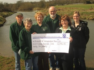 Ann Briggs, manager of the Tamworth Co-op convenience store (front right), presents Pam Clark, secretary of the Friends of Warwickshire Moor, with a cheque for £745. Also pictured are volunteers Malcolm Sanford, Pauline Sanford, Tom Barker and project manager Lindsey Bates from Staffordshire Wildlife Trust.