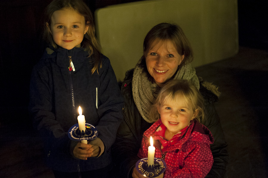 Imogen (7) and Hattie (2) Slesser-Hutchings lit candles for their grandmother and great grandmother, with their mother Joanne.