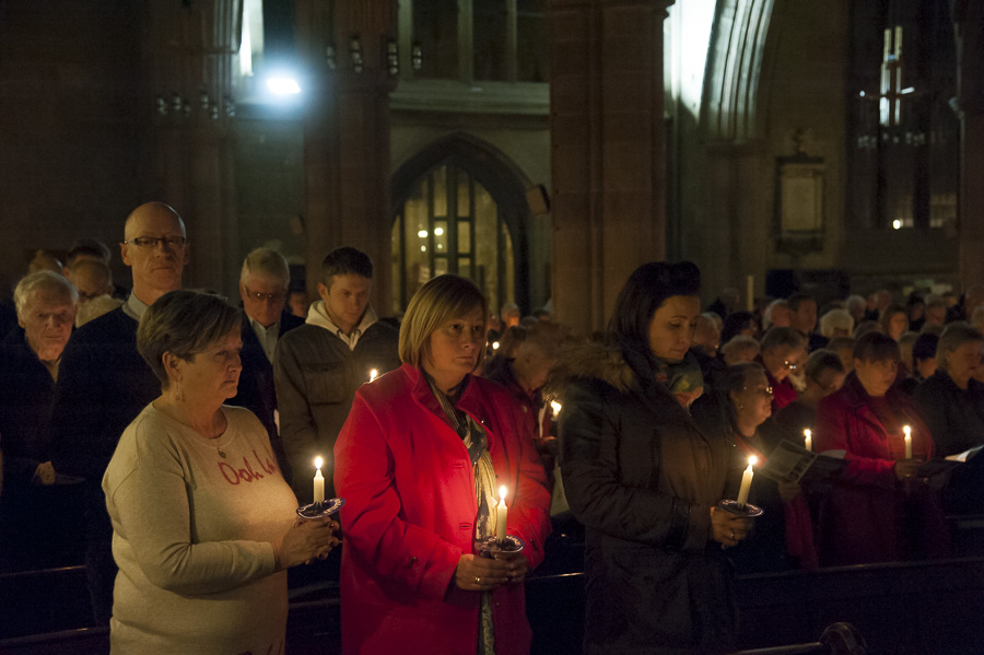 From left to right Sandra Mould, Cherie Nasser and Haidee Riding join the candlelit tribute. Cherie wore a pink coat in memory of her mother Winifred Page who loved the colour and went on her final journey in a pink hearse.