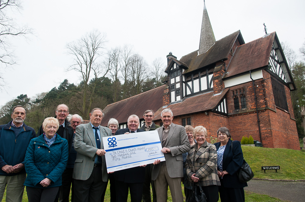 Members of St Chad's congregation turned out for the presentation. Pictured holding the giant cheque are Ron Constable, general manager of Tamworth Co-op's non-food division (centre), warden Derek Johnson (right) and St Chad's treasurer Roy Jones (left).