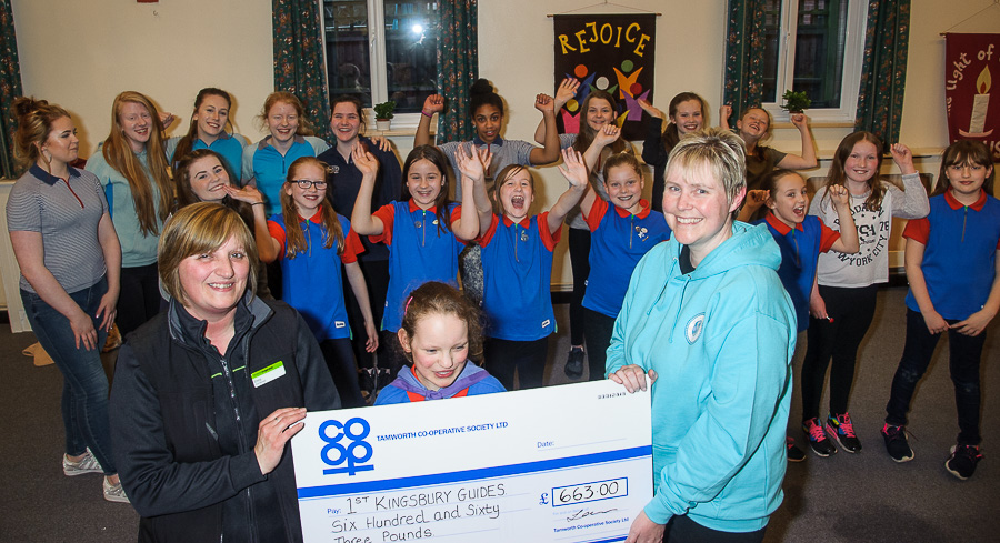 1st Kingsbury Guides leader Sallyann Blackett receives cheque for £663 from Emma Horsham, manager of Kingsbury convenience store.