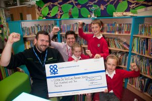 Neil Wakelin, manager of Tamworth Co-op Rosliston convenience store, hands over cheque to Lee Smith, head teacher Coton-in-the-Elms Primary School, with nine-year-old pupils Owen Ford, Rosie Robinson and Grace Simpkin.