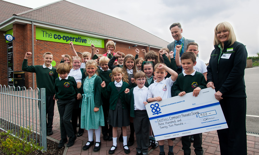 Vicky Freeman, manager of Tamworth Co-op convenience store in Dosthill, presents cheque for £922 to Dosthill Community Primary School pupils. Head teacher Tony Hand and bursar Sue Marriott are also on the picture.