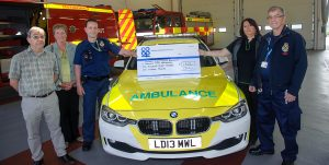 At cheque presentation with First Responder vehicle in foreground are TAME treasurer Melvin Watson, Susan Dawson, group secretary, Tamworth Community First Responder John Thompson, Julie Clark, manager of Tamworth Co-op supermarket, and TAME co-ordinator Keith Dawson.