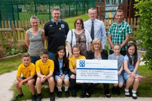 Pictured at cheque presentation in prayer garden are Sam Herne, Daniel Perks, Francesca Pursglove, Aoife Hitchings, Julie Gasper, Tamworth Co-op business support manager, Maddie Booth and Evie McGowan, with Friends of St Gabriel's members Louise Vernon, Steve Pursglove (treasurer) Mairead Hitchings, John Hayes, head teacher of St Gabriel's Primary School, and Rob Vernon (chairperson).
