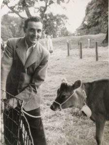 Farmer Frank Swinnerton as young man with one of his cows.