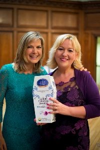 Amanda Woodward, general manager of Tamworth Co-op funeral division, receives top award from former GMTV host Penny Smith.