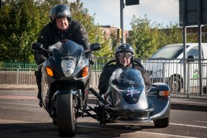 Glen and Paul arrive at Tamworth Co-op funeral branch in a sidecar packed with chocolate.