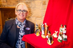 Funeral director Lorraine Walker pictured with nativity scene on display during Christmas Memorial Service at Woodville Methodist Church.