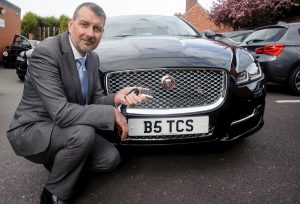 Glen Speak, deputy manager of  Tamworth Co-op's funeral division, collects keys for new luxury vehicles.