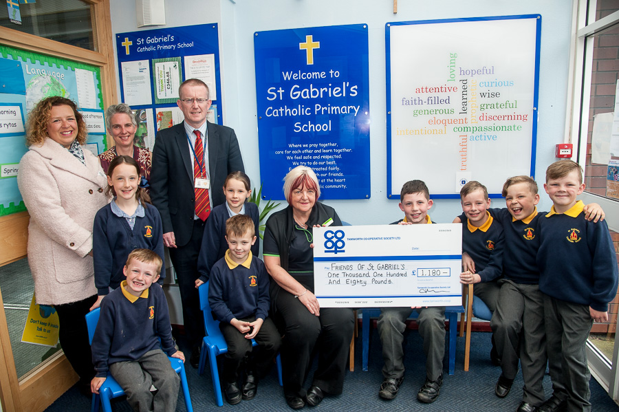 Annette Brindley, manager of Tamworth Co-op convenience store in Glascote, hands over cheque from Community Dividend Fund to pupils from St Gabriel's Primary School. Looking on are (left to right) Clare Nelson, a member of Friends of St Gabriel's, Louise Vernon, group's chairperson and head John Hayes.