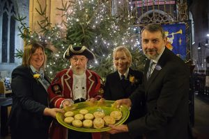Town crier Ken Knowles is treated to mince pie by Tamworth Co-op funeral staff. Pictured with him (from l-r): are Cheryl Dutton, Amanda Woodward and Glen Speak.