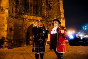 Piper Alan Hillier and town crier Ken Knowles outside St Editha's Church, Tamworth.