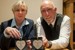 Tamworth Co-op staff, Michaela Charles and Martin Wassall, hold up the Valentine's Day glass hearts.