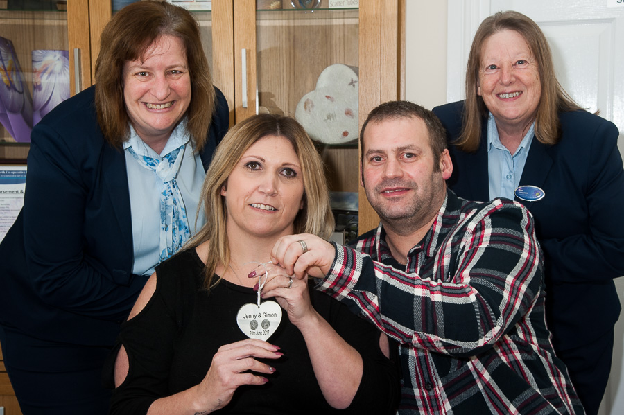 Jenny and Simon Williams collect their prize glass heart from Tamworth Co-op Bereavement Advice Centre where fingerprint scans were taken. Pictured with them are funeral arrangers Cheryl Dutton and Anne Livingstone.