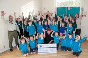 Sheila Villers, manager of Wood End Co-op, presented cheque for £500 from Community Dividend Fund to beavers, cubs and scouts who cheered to show their appreciation.