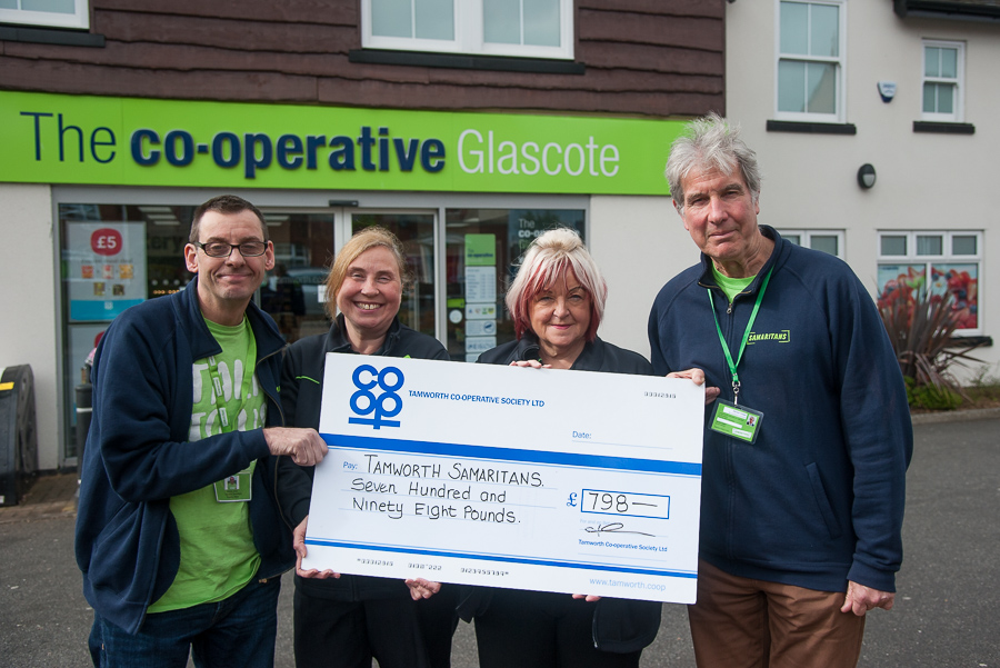 Annette Brindley, manager of Glascote Co-op, presents cheque for £798 from Community Dividend Fund to Gerwyn Cooper, Tamworth Samaritans branch director, watched by Wayne Jones, group's publicity and outreach officer, and Glascote Co-op sales assistant Pam Matthews.