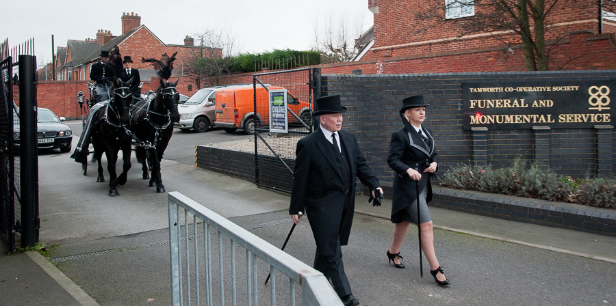 Bill Galvin walks ahead of horse-drawn hearse with his trademark cane. Pictured alongside him is Amanda Woodward, general manager of Tamworth Co-operative Society's funeral service.