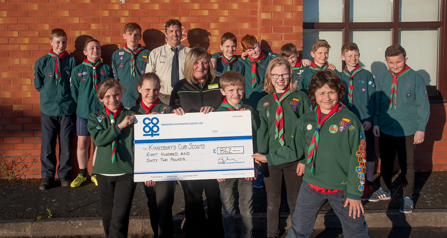 Emma Horsham, manager of Kingsbury Co-op, hands over Community Dividend Fund cheque to members of 1st Kingsbury Scout Group and their leader Paul Carter (centre).