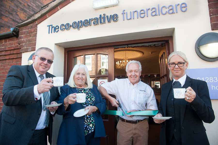 Pete Massey, MD of Masseys DIY store, cuts ribbon to open coffee morning. Pictured with him are funeral celebrant Chris Knight, Woodville Co-op funeral arranger Sandra Wyatt and funeral director Lorraine Walker.