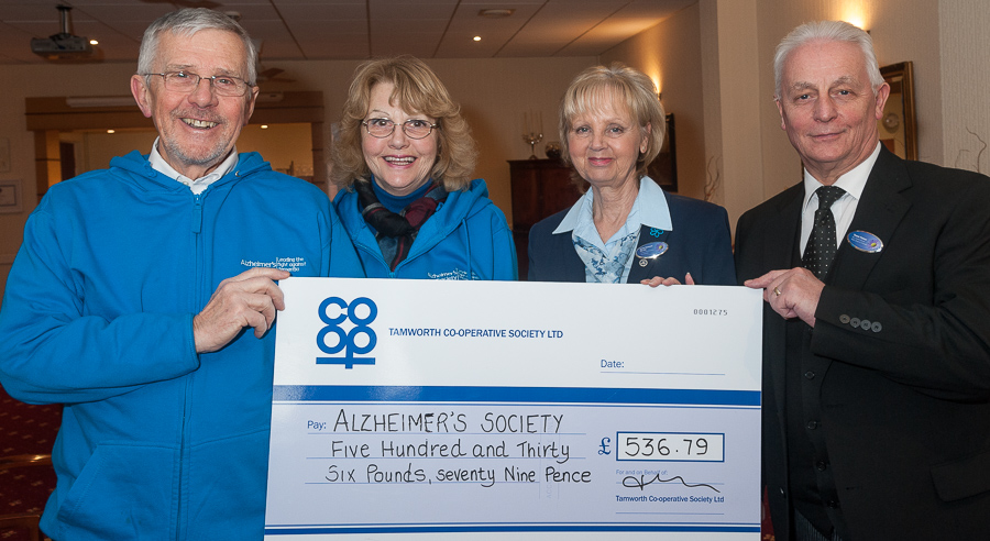 Alzheimer Society volunteers David and Margaret Barnes pictured at Tamworth Co-op funeral premises in Upper Gungate, receiving cheque for £536.79 from funeral staff Janice Chetwynd and Trevor Palmer.