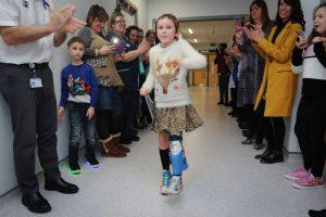 Amelia Eldred walking on her new artificial limb at Birmingham Children's Hospital.