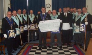 Members of Acacia Freemasons Lodge with cheque