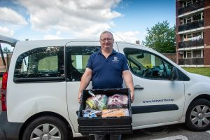 Tamworth Co-op home delivery driver with crate of groceries