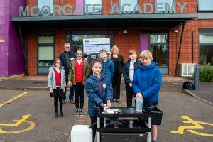 Pupils with portable sink donated by Tamworth Co-op shoppers