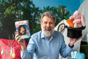 Tamworth Co-op funeral manager with Easter egg and top hat with bunny coming out