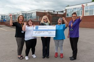 Stretton Co-op Community Dividend Fund cheque presentation to staff and pupils